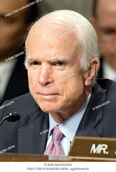 United States Senator John McCain (Republican of Arizona), Chairman, US Senate Committee on Armed Services, listens as Secretary of Defense James N
