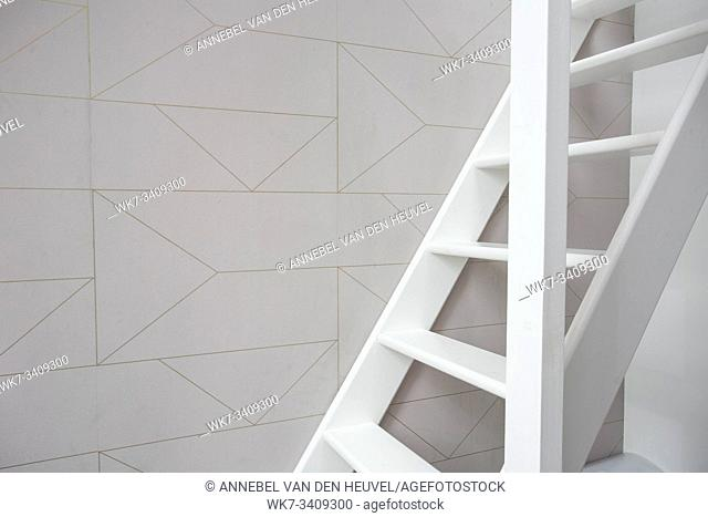 Stairs in modern white room, white wooden stairs with white wall modern retro wallpaper