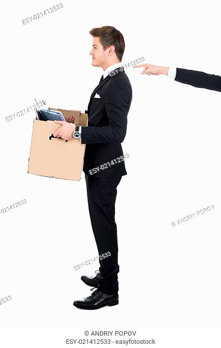 Businessman Carrying Cardboard Box With Hand Pointing At Him