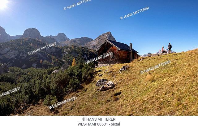 Germany, Bavaria, Upper Bavaria, Berchtesgadener Land, Berchtesgaden National Park, couple at mountain hut