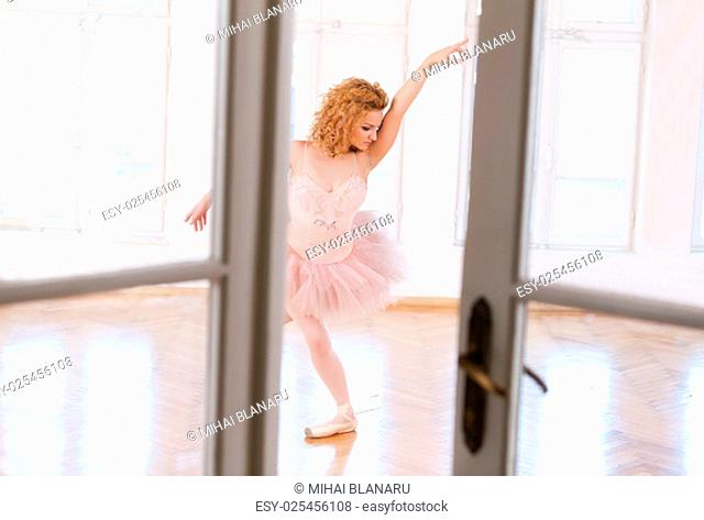 Blonde ballerina performing an exercise