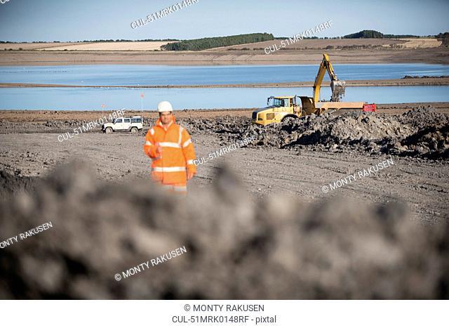 Worker walking on surface coal mine