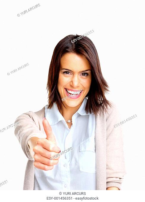 Portrait of a happy young woman with thumbs up sign against white background
