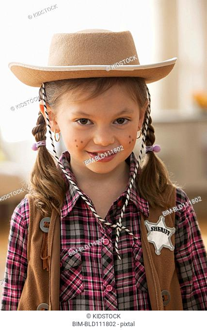 Caucasian girl wearing sheriff costume