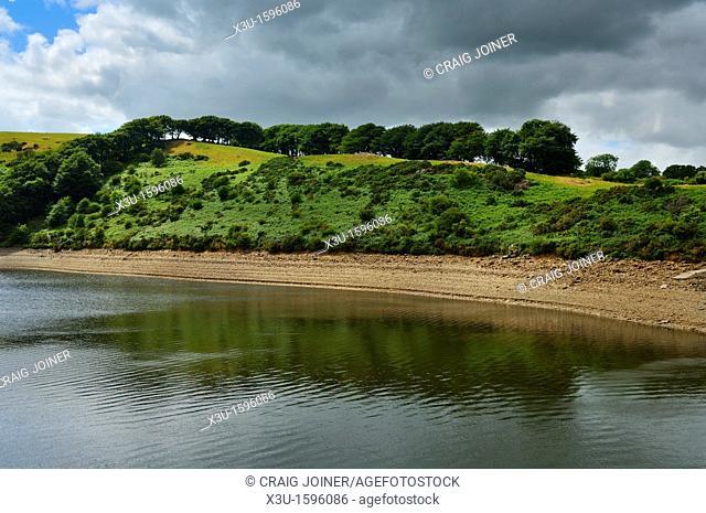 Low water level in Meldon Reservoir during a dry summer in Dartmoor National Park near Okehampton, Devon, England, United Kingdom