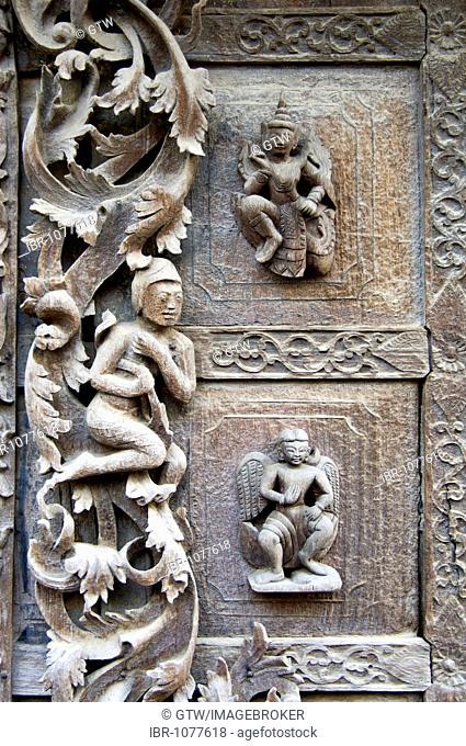 Carved teak figures, Monastery Shwe In Bin Kyaung, Mandalay, Myanmar, Burma, Southeast Asia