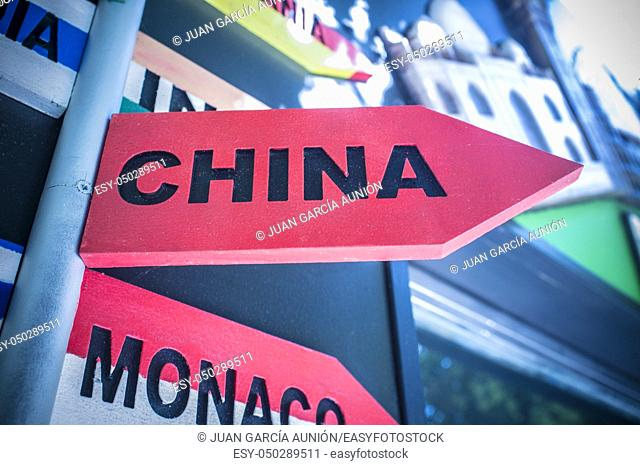 Pole guidepost with China sign and flag as background. Travel concept