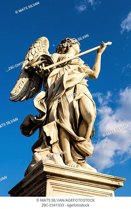 Statue on sant'angelo bridge in a sunny day with blue sky and clouds in Rome, Italy