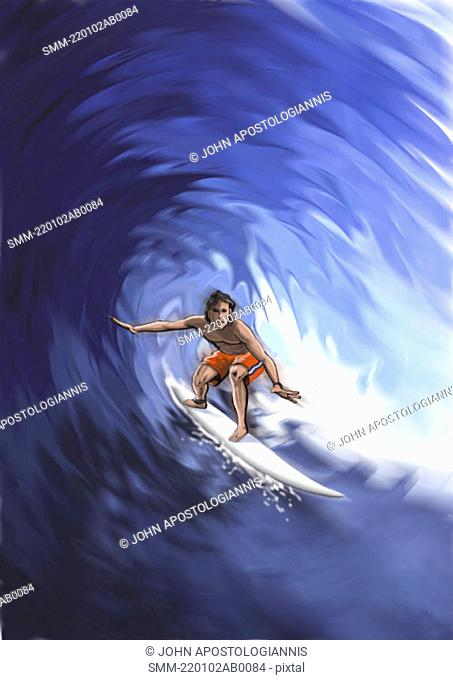 Young man surfing a wave