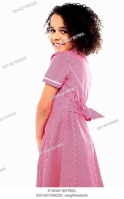Shy school girl in pink uniform