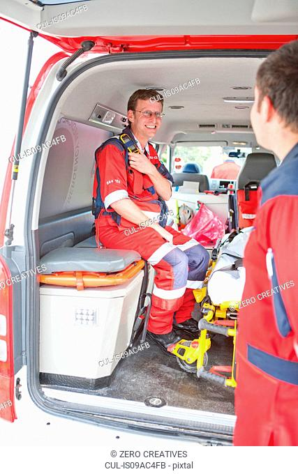 Paramedic in ambulance waiting for call