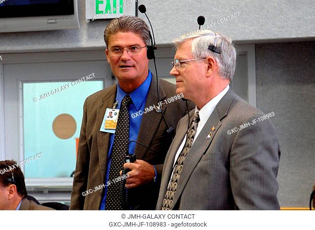 In the firing room of the Launch Control Center at NASA's Kennedy Space Center, KSC Director Bill Parsons (left) and Johnson Space Center Director Michael Coats...