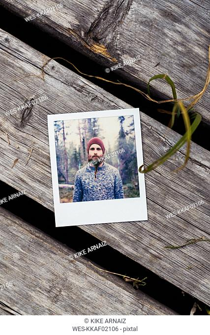 Instant photo of young man on boardwalk