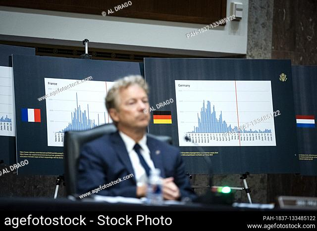 Charts of coronavirus data from France and Germany are seen as United States Senator Rand Paul (Republican of Kentucky), listens during a Senate Health