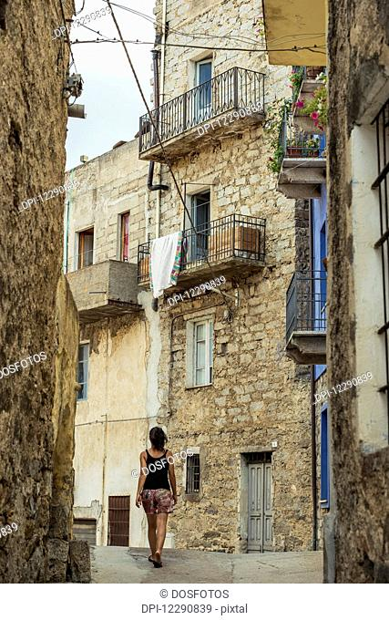 Street with old stone buildings; Orgosolo, Sardinia, Italy