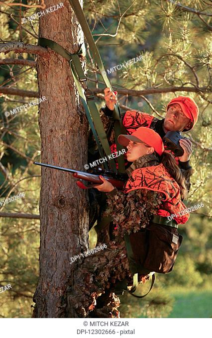 Female Hunter Climbs Into Tree Stand While Deer Hunting