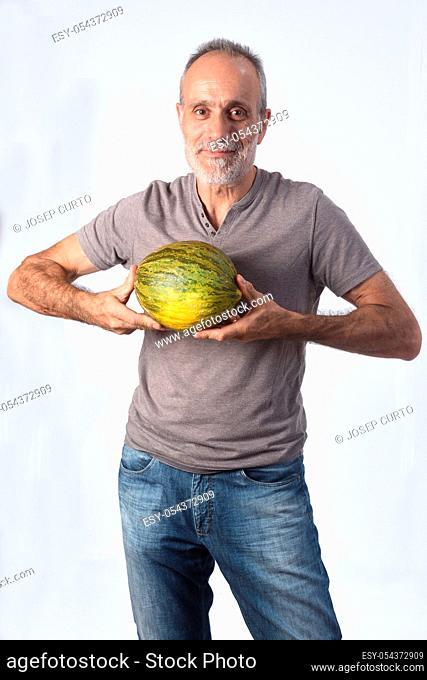 man with cantaloupe on white background