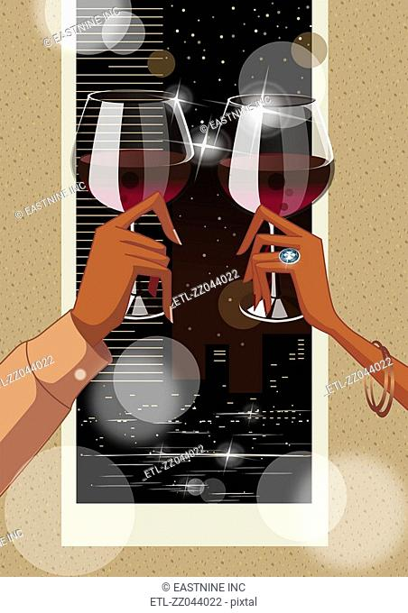 Close-up of a couple's hands toasting with wine glasses