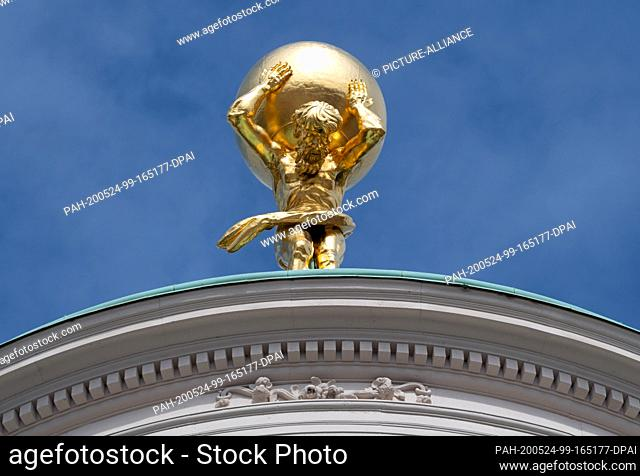 18 May 2020, Brandenburg, Potsdam: The figure of Atlas stands on the roof of the Old Town Hall on the Old Market Square. The 650-kilogram bronze Atlas had been...