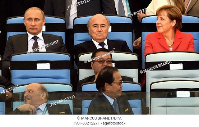 Russia's President Vladimir Putin (L-R), FIFA President Sepp Blatter, and Germany's Chancellor Angela Merkel watch the opening ceremony of the World Cup final...