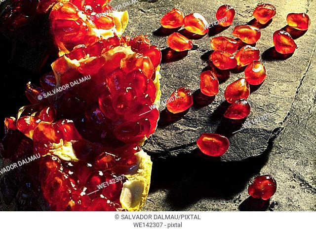 photography studio,creative fruit,pomegranate on slate,location girona,catalonia,spain,europe,