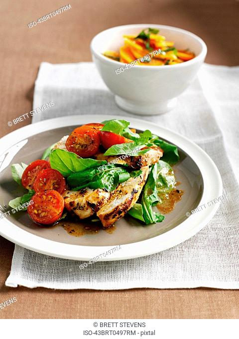 Plate of chicken with salad