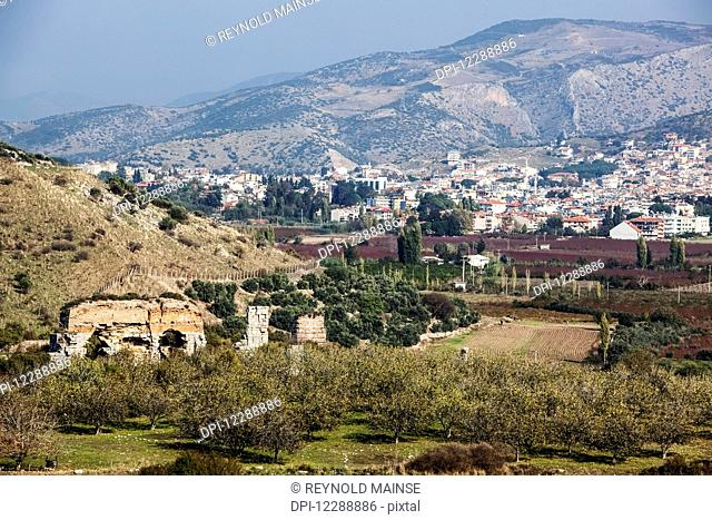 An ancient wall and landscape of Selcuk, near the ancient city of Ephesus; Ephesus, Turkey