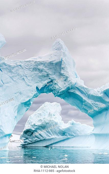 Huge arched iceberg near Petermann Island, western side of the Antarctic Peninsula, Southern Ocean, Polar Regions