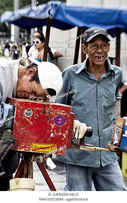 Local Photographer with 100 year old wooden Camera, Havanna, Cuba