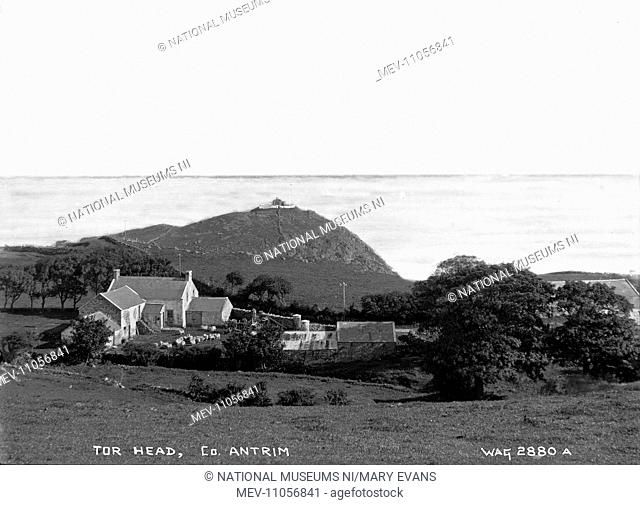 Tor Head, Co. Antrim - a view of the headland, with a farm in the foreground. (Location: Northern Ireland; County Antrim; Torr Head)