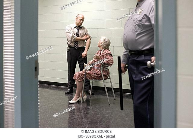Senior woman being questioned