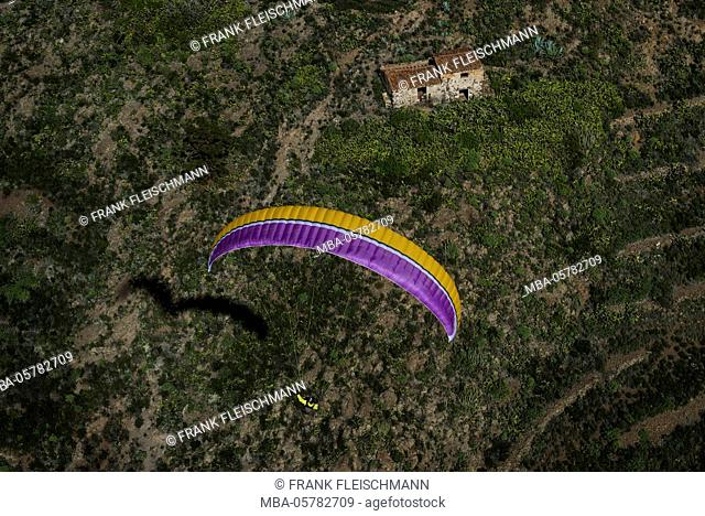Paraglider about volcano scenery with Finca, aerial picture, Canary islands, Tenerife, Spain