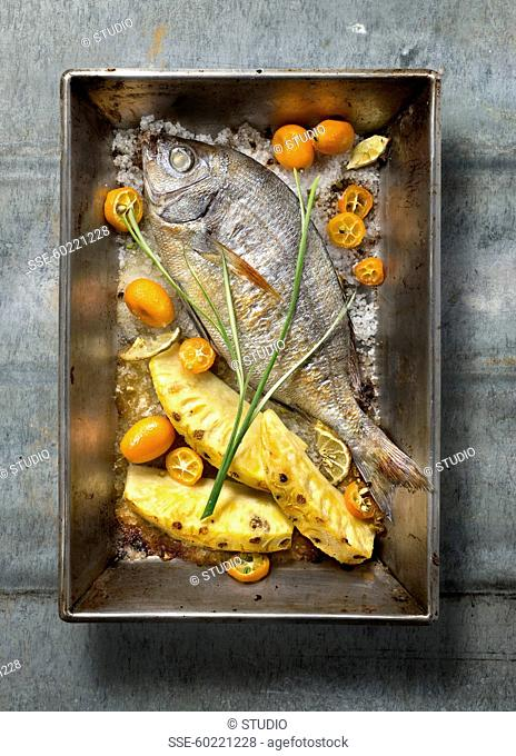 Oven-baked sea bream with pineapple and kumquats