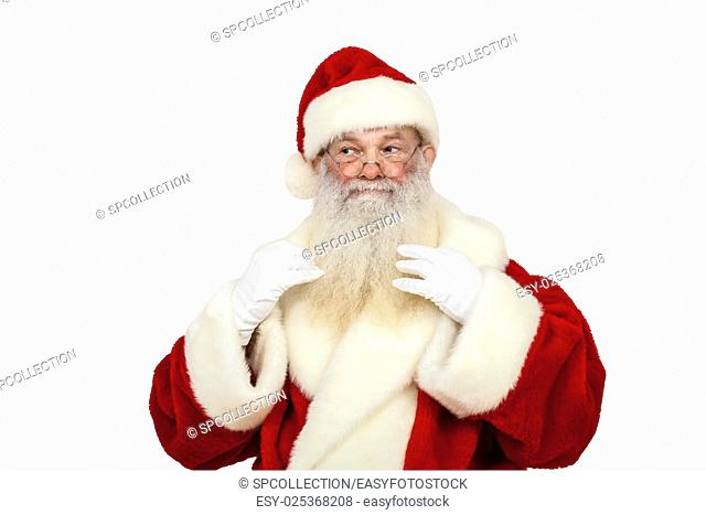 Santa Claus with real beard is tweaking his beard (isolated)