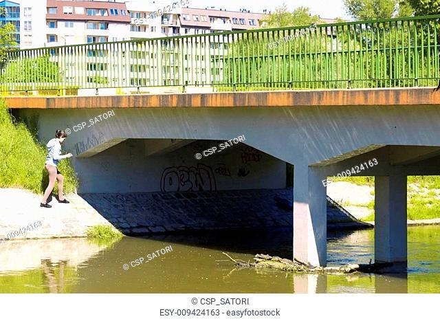 Teenage girl walking on the bridge