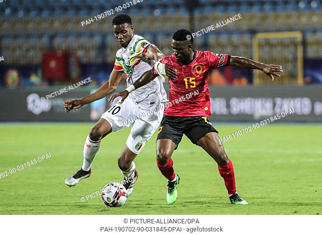 02 July 2019, Egypt, Ismailia: Mali's Kalifa Coulibaly (L) battles for the ball with Angola's Bastos during the 2019 Africa Cup of Nations Group E soccer match...