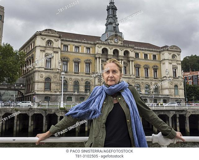 Portrai of woman in front of the city hall of Bilbao, Basque Country, Spain