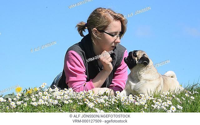 Woman lies with a pug