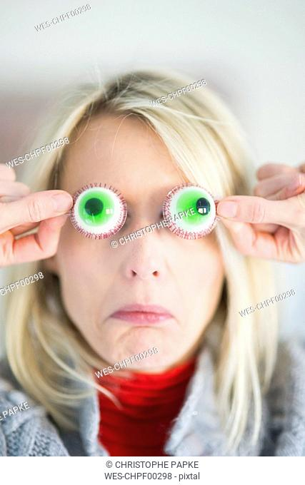 Woman with artificial sweets eyes