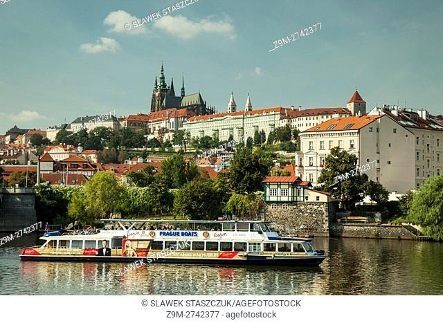 Hradcany towering above Vltava river in Prague, Czech Republic