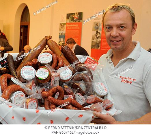 Master butcher Matthias Bothe from Geltow presents sausage specialities at a press conference for Berlin International Green Week in Potsdam, Germany