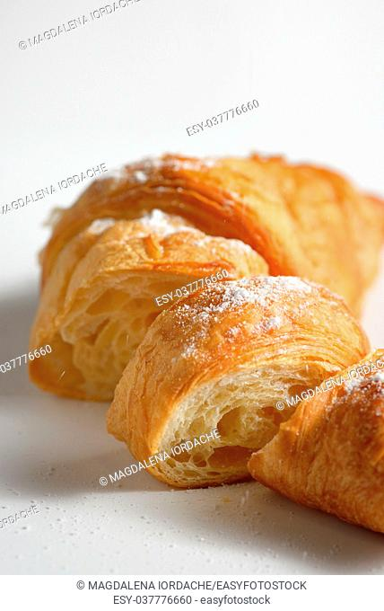 Sliced fresh and tasty croissant