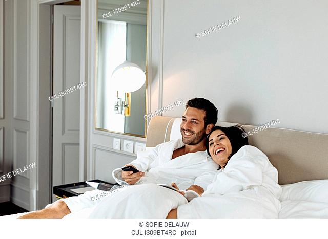 Couple laughing and relaxing in suite