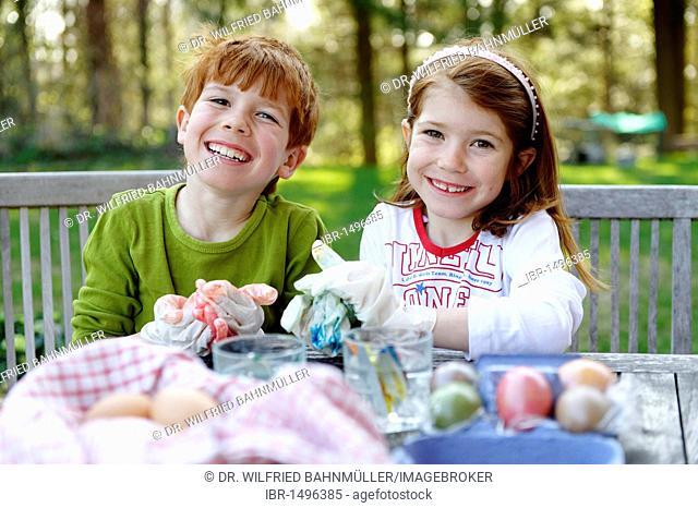 Children painting easter eggs, Easter preparation