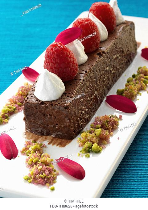 A whole chocolate marquise with raspberries and cream gourmet dessert