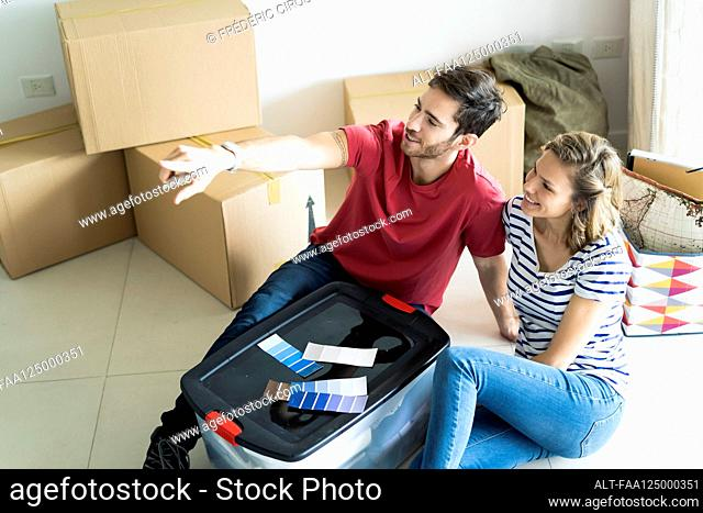 Young couple discussing in new house