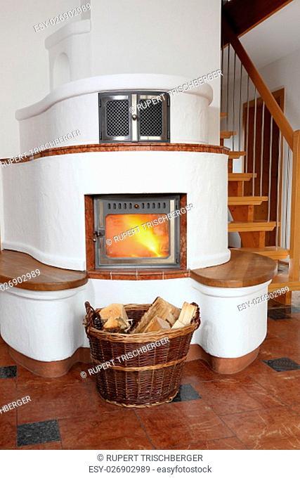 burning wood stove with wood basket