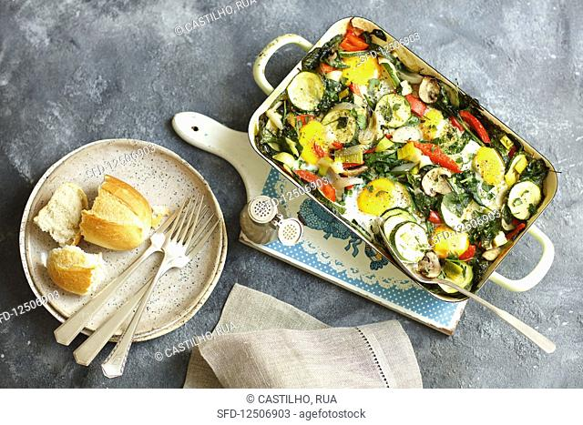 Eggs with oven-baked vegetables in a baking dish