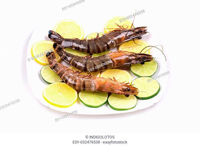 Fresh shrimps with lemon. Whole background and closeup