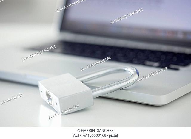Padlock resting on laptop computer
